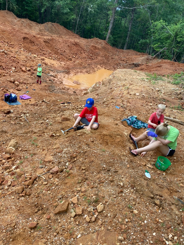 Kid field trip getting muddy at Wegner Crystal Mine in Arkansas