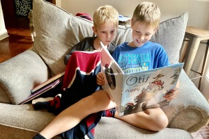 Brothers Reading a Picture Book