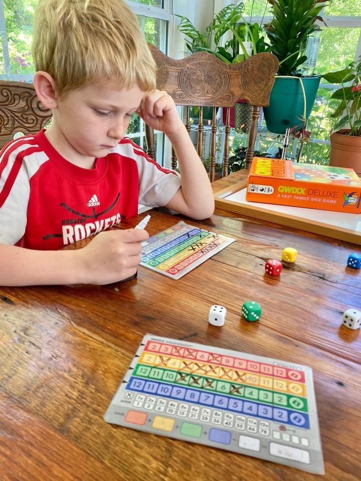 Boy playing Quixx