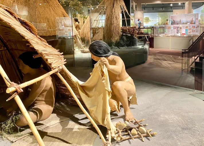 Mississippian Preparing the Sweat Lodge in the Village Reproduction