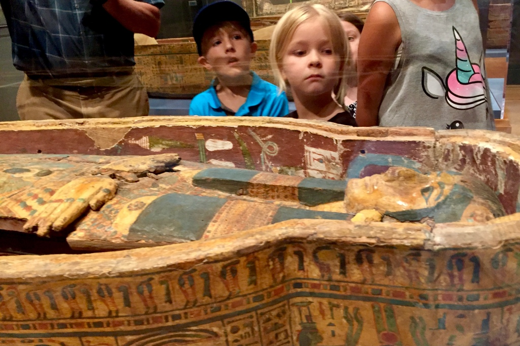 Looking at an Egyptian Sarcophagus and Coffin on a School Field Trip